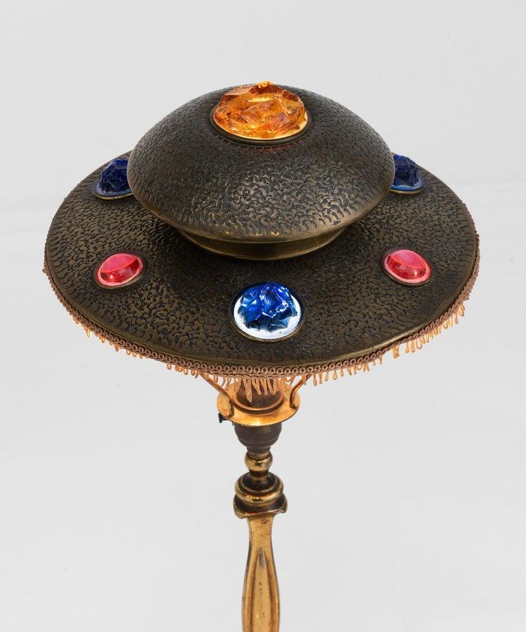 Original, hand beaten brass shade with inset colored glass gems.