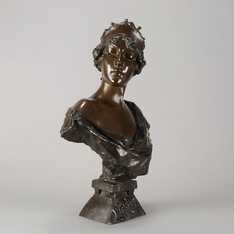 A entrancing late 19th century French Art Nouveau bronze bust entitled 'Lucrece', of a beautiful classical lady modeled in the Art Nouveau style with excellent rich brown variegated patina and smooth tactile surface detail. Signed E Villanis,