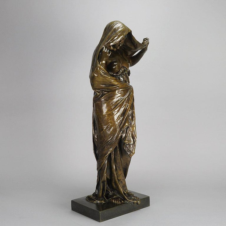 A stunning late 19th century French bronze entitled 'La Nature se dévoilant devant la Science' by Louis Ernest Barrias, the figure of a seductively draped female figure representing, in allegorical form, Nature revealing her secrets to Science, a