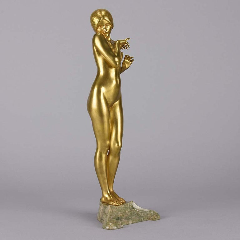 A wonderful sensuous Art Nouveau early 20th century gilt bronze figure of a beautiful naked lady standing in a coy pose, the surface of the bronze with a wonderful smoothg tactile finish. Raised on a shaped marble base and signed L.Chalon  Louis