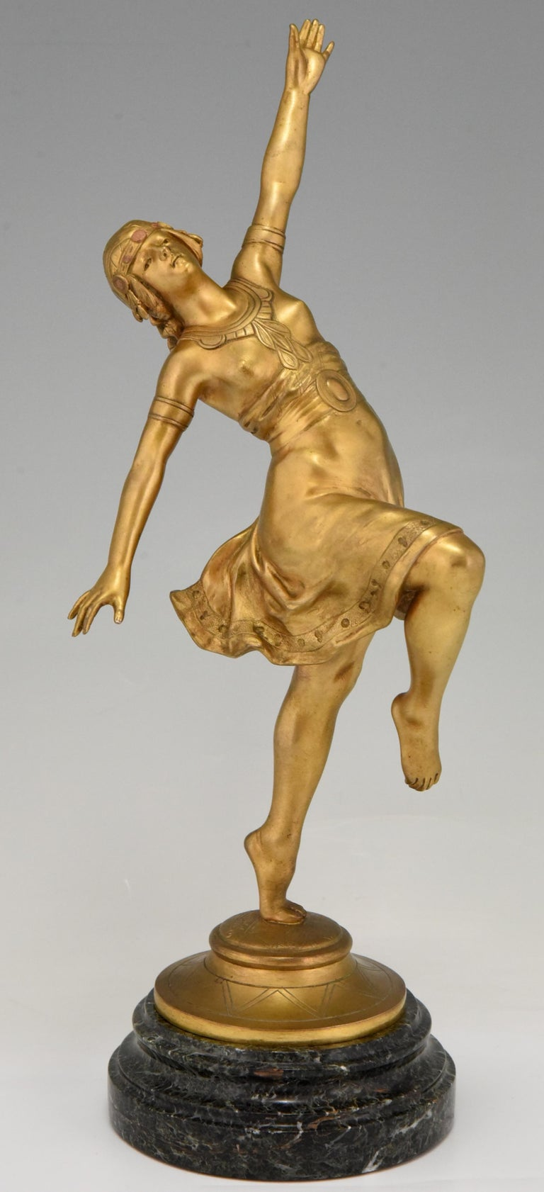 Art Nouveau bronze sculpture of an Oriental dancer.  By the sculptor Jean Garnier, born in France in 1853. With Founders signature of C. Villain.  The sculpture has a gilt patina and stands on a circular marble base.