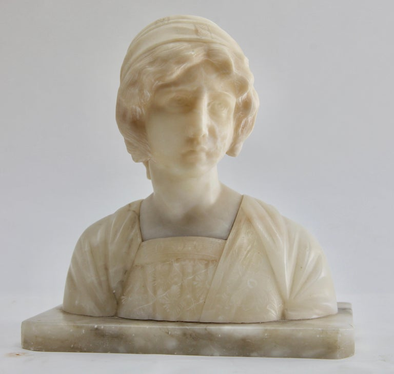 Art Nouveau bust alabaster, Italy, circa 1930  Lovely Art Nouveau bust of a young woman made in Italy at the beginning of the 20th century. Worked out of Fine alabaster the sculptor took greatest attention on details. Just watch the facial
