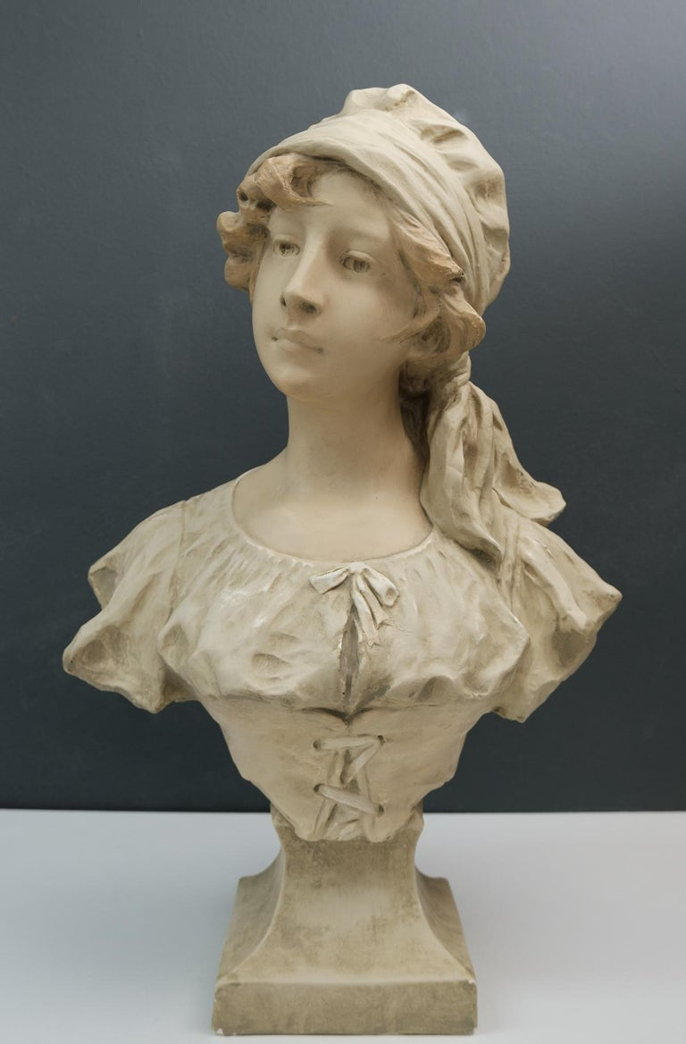 Art Nouveau bust off a young girl. France, circa 1900. Beautiful girl, looking a little stubborn. Signed H. Laurens Plaster.