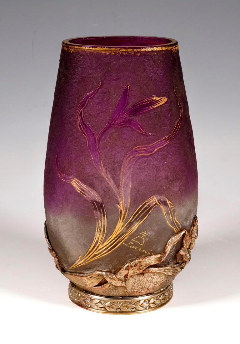 Vase in oval, bulbous shape, tapering straight towards the top, cut, gilded mouth rim, colorless glass with violet meltings in the upper area, decor of iris flowers with stem and leaves in high cut and provided with gold heightening, satined surface