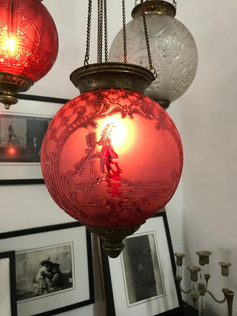 Late 19th or early 20th century ruby red glass Lantern by Baccarat France, unsigned but a well documented model. It has 3 panels depicting a Windmill, a farmhouse and a Greek temple. At the moment it can hold a candle (we recommend using Battery