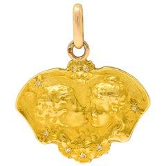 Art Nouveau Diamond 18 Karat Two-Tone Gold Child Pendant