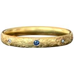 Art Nouveau Diamond and Sapphire Hinged Engraved 14 Karat Yellow Gold Bangle