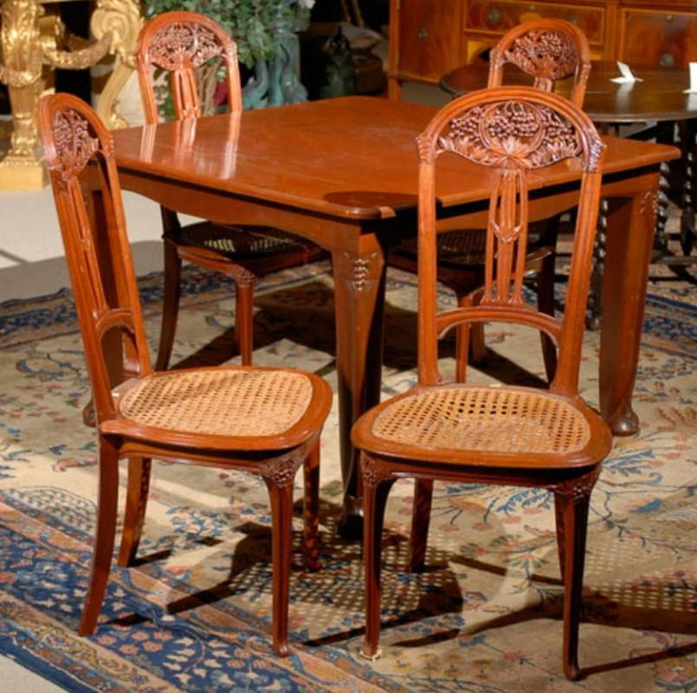 A superb Art Nouvea set by Louis Marjorelle. Table & six chairs. Two leaves. France, circa 1920. CW3882