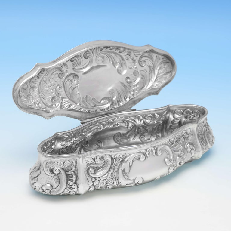 Hallmarked in Chester in 1904 by William Neale & Son Ltd., this attractive, Art Nouveau influenced, antique sterling silver trinket box, features chased decoration throughout, and bead borders. The box measures 1.5