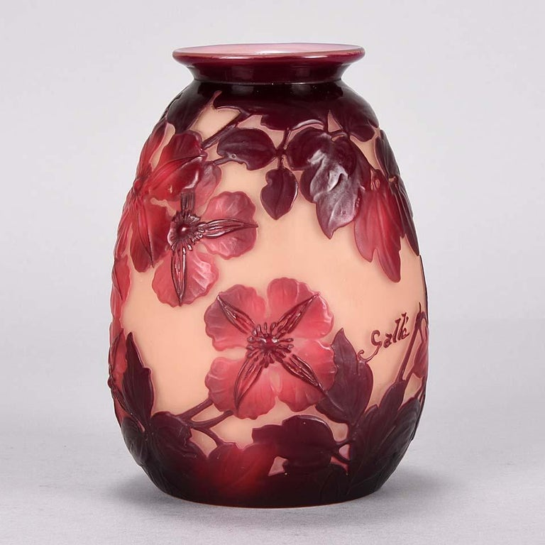 A very pretty early 20th century Art Nouveau cameo glass vase with attractive burgundy and deep red flowers against a peach field, signed Gallé 