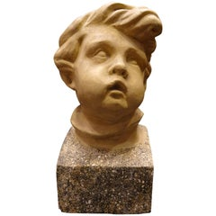 Art Nouveau French School Plaster Carved Child Bust with Base Imitating Stone