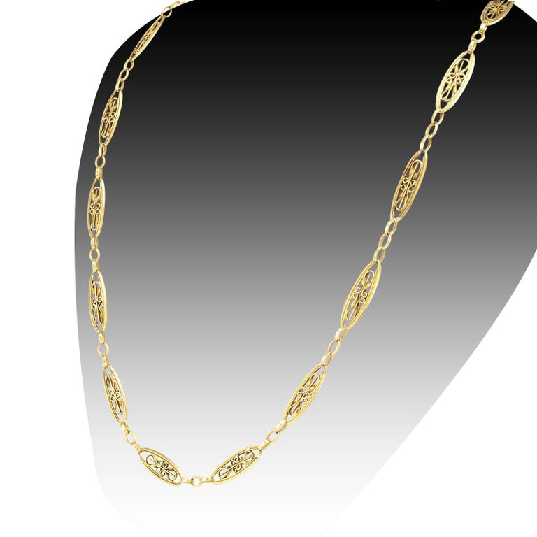 """Art Nouveau French yellow gold chain necklace circa 1905.   DETAILS:  METAL: 18-karat yellow gold.  MEASUREMENTS: approximately 21"""" (53.3 cm) long and 5/16"""" (7 mm) wide overall, 21.4 grams.  HALLMARKS: French.  CONDITION: high magnification"""