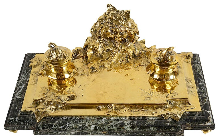 A very comprehensive five piece, late 19th century gilded bronze Art Nouveau desk set by ; Albert Marionnet (1852-1910). Each piece have these mythical busts coming out of the ground with Ivy wrapped around him, signed A. Marionnet. Mounted on