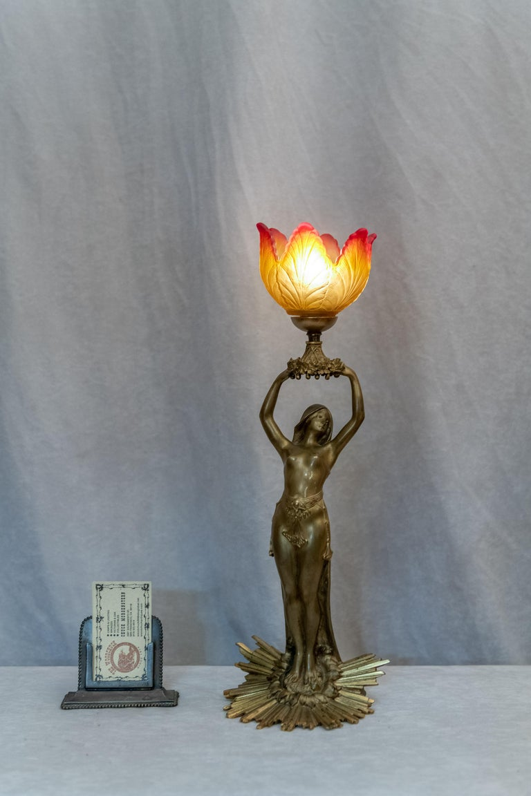 We try to buy the best of our favorite style, Art Nouveau. This figural lamp is a real little gem. Artist-signed A. Fery and we believe it was done circa 1900. The base on which this lovely gal stands is the epitome of the beauty of Art Nouveau.