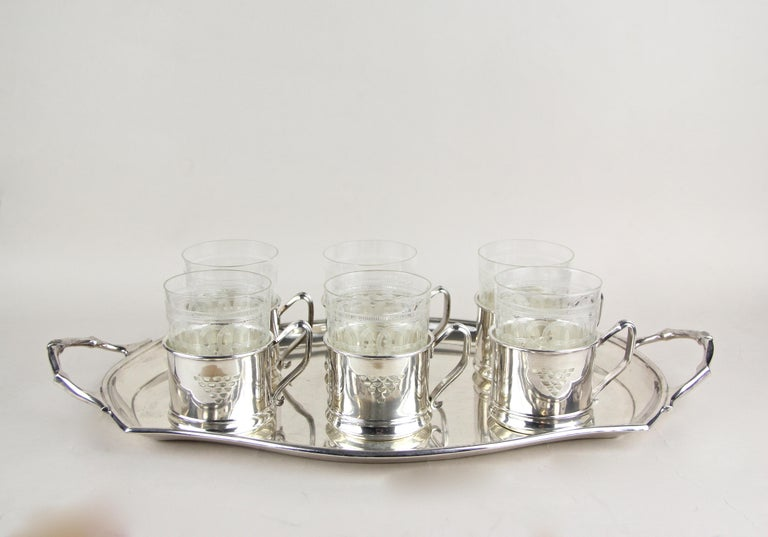 Lovely set of six Art Nouveau glasses on silvered tray by Argentor from circa 1910. Made by the famous company of Argentor in Vienna - Austria, the beautiful engraved glasses show a mesmerizing design and look absolute fantastic in combination with