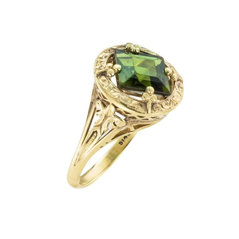 Art Nouveau green tourmaline and yellow gold ring circa 1905.  We are here to connect you with beautiful and affordable antique and estate jewelry.  The facts you want to know are listed below.  Read on.  It is remarkably short, simple, and clear.
