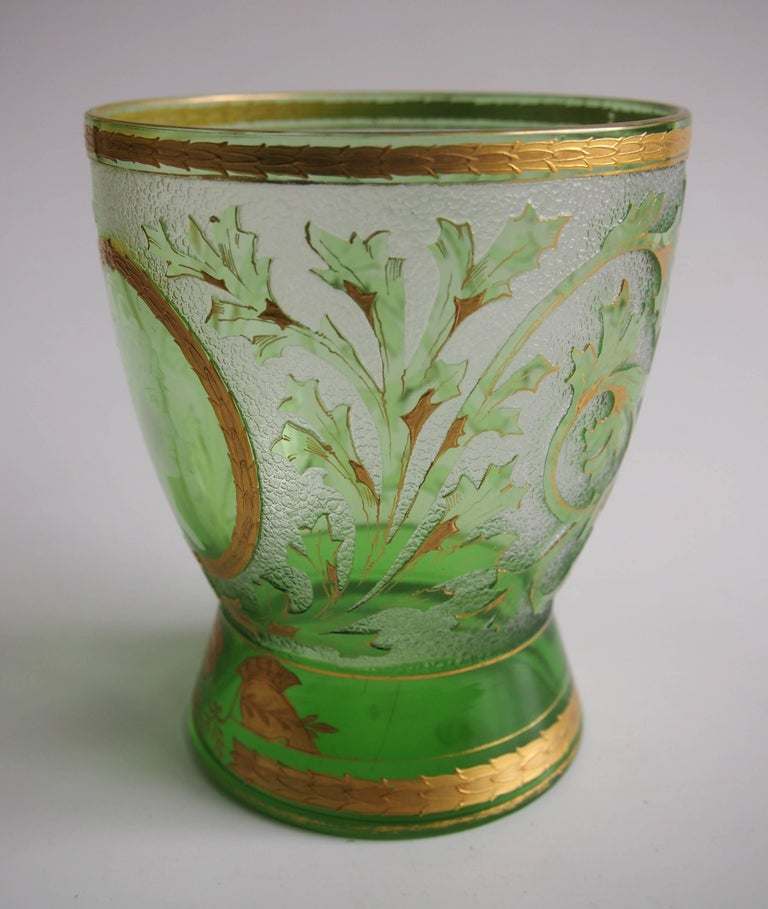 Stunning Riedel cameo and gilded, green on clear - 'Helmet' vase. The main body is decorated with green leaves and branches highlighted by gilding. It has a very fine white profile face of a lady in a gold cartouche. It's in the Riedel book and