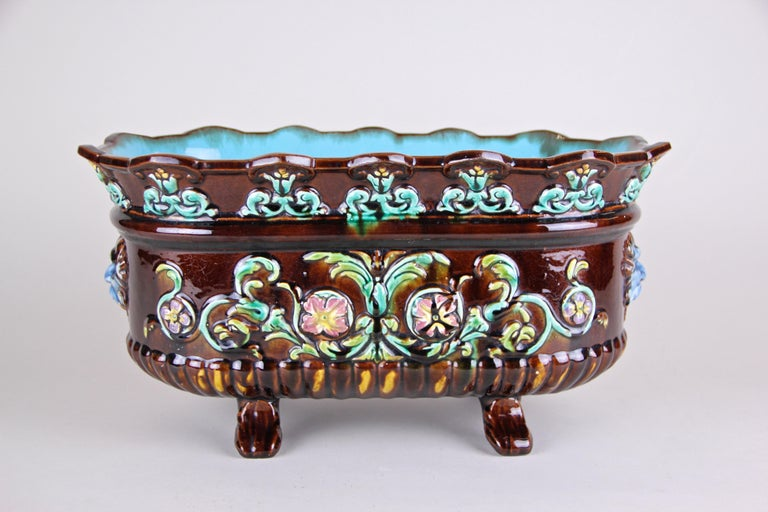 Exceptional colorful Majolica jardinière or cachepot from Art Nouveau period around 1915 in France. An unusual shape, delicate floral design elements and a beautiful coloration in brown, green, red and blue tones combined makes this piece of french
