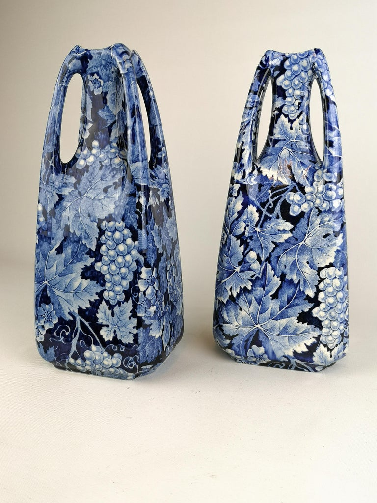These vases are from the early 1900s and where produced by Rörstrand in Sweden. The name of the vases is Druva and translates to Grape which is exactly what the vases are decorated with.  They are both in very good condition considering the age.