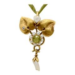 Art Nouveau Peridot, Pearl and Diamond Pendant on Silk Cord, circa 1920s