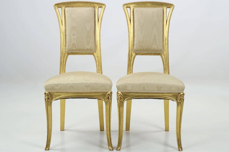A perfectly designed and proportioned pair of giltwood side chairs, designed almost certainly by the firm of Louis Majorelle during the first years of the 20th century, they exhibit precise and gorgeous craftsmanship throughout their remarkably