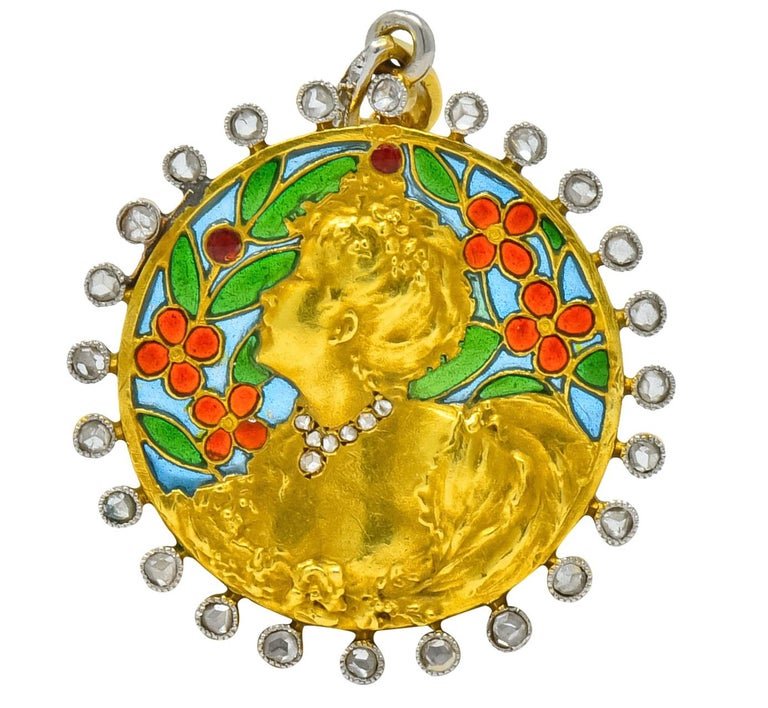 Centering a round disk pendant depicting a highly rendered, impressionist inspired, image of a fancily dressed woman  With red and green floral foliate plique-à-jour enamel background   Surrounded by rose cut diamonds, bezel set in millegrain