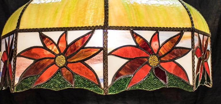 Stunning Art Nouveau leaded glass French lamp, in different colors, circa 1900.