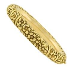 Art Nouveau Repousse Gold Bangle Bracelet with Flower Motif
