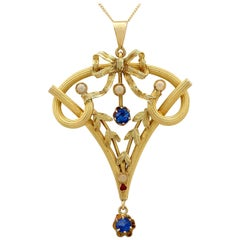 Art Nouveau Ruby Sapphire and Seed Pearl Yellow Gold Pendant
