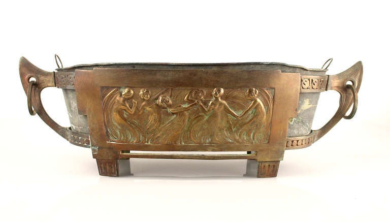 Antique Art Nouveau Jardiniere/centerpiece, circa 1870-1880. The overall shape seems to be taken from a viking drakkar with the mooring rings and celtic symbols, while the center theme featuring a circle of woman holding hands and dancing.