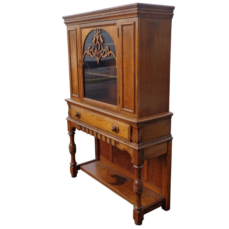 Art Nouveau display cabinet by Limbert Van Raalte Craftsman Furniture American, 1920s   Beautiful example of Arts & Crafts cabinet. Art Nouveau appliques' on glass and carved pulls.  One large drawer with dove tail joints and shelving