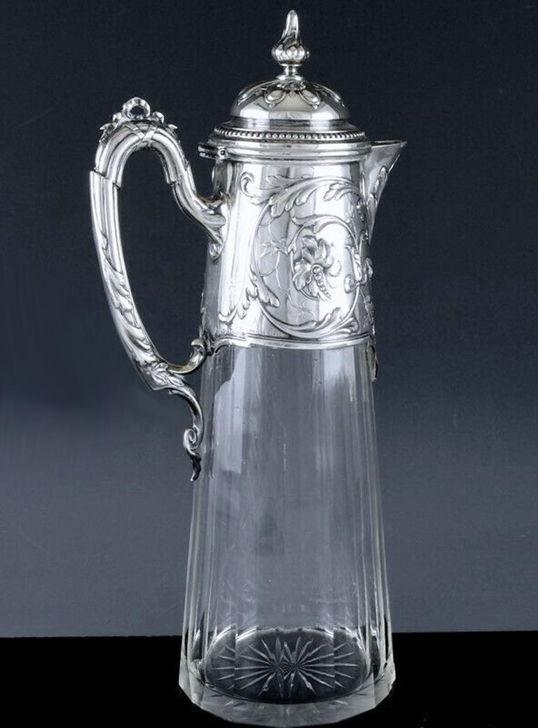 Art Nouveau silver and glass claret jug, Germany circa 1900 J. Mayers Sohne, Austrian import marks. Fine Art Nouveau silver cover, upper body and handle. The glass body slightly tapered ribbed panels surround. Stamped with German silver marks,