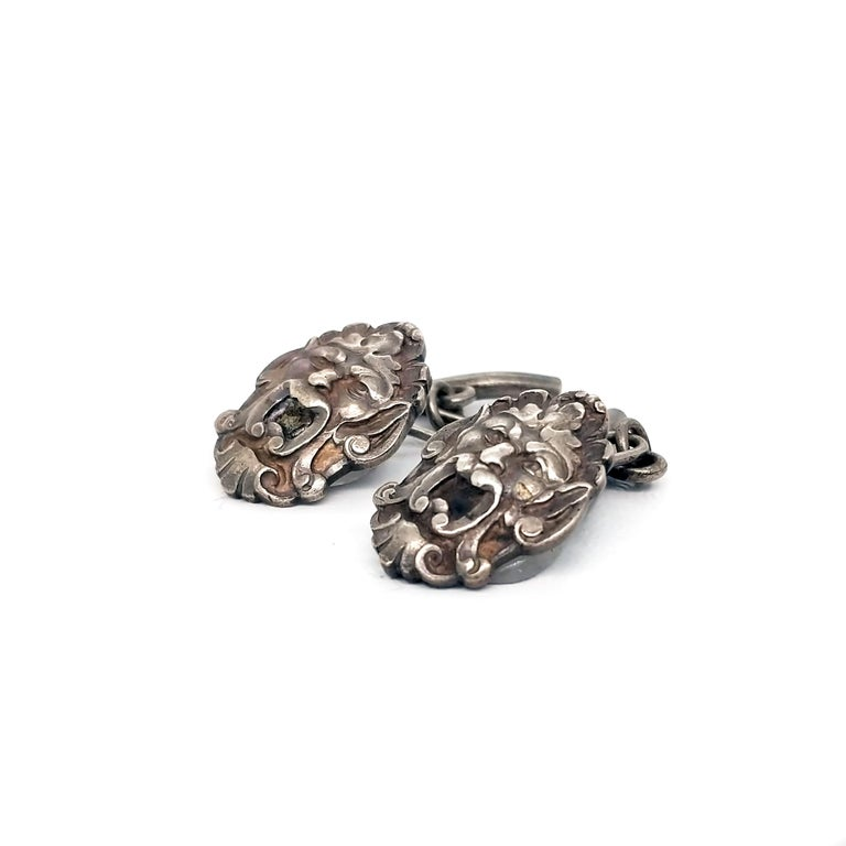 These Art Nouveau cufflinks are sure to wow! Made of sterling silver and hand-engraved with gargoyle faces, these cufflinks are sure to add some spice to your look!  These open-mouthed gargoyles would make just the perfect addition to your