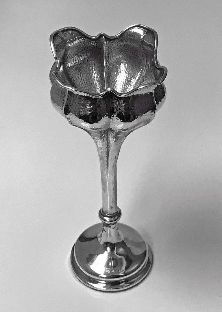 Antique Art Nouveau hammered Sterling Silver flower vase, Birmingham 1902 Henry Matthews. The vase on plain moulded pedestal base, rising to plain knopped stem and flared spot hammered ruffle edge tulip design holder. Measures: Height 7.25 inches.