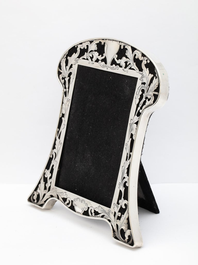 Art Nouveau, sterling silver-mounted picture frame, George A. Henckel and Sons, New York, Ca. 1909. Piercings in the sterling silver allow the black velvet to show through. Sterling silver is beautifully detailed - leaves, flowers and vines whip