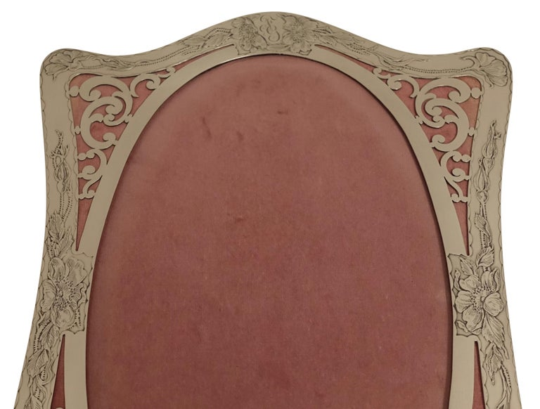 Art Nouveau style sterling silver easel back picture frame with repousse detail of wild flowers and monogram