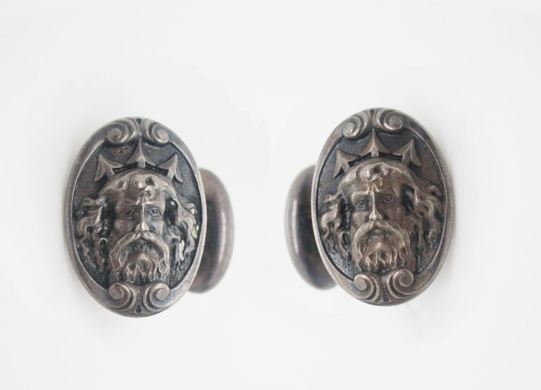 These incredible cufflinks are in sterling silver and feature a fantastically ornate depiction of the sea god Poseidon or Neptune. The detail of the portrait is remarkable-even the hairs of his beard are detailed! The incredibly unique look of these