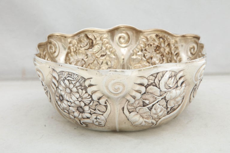 Art Nouveau, sterling silver serving bowl, Whiting Manufacturing Co., New York, circa 1900. Chased with lovely flowers. Measures 3 1/2 inches high x 8 1/2 inches diameter. Weighs 12.910 Troy ounces. Dark spots in photos are reflections. Excellent