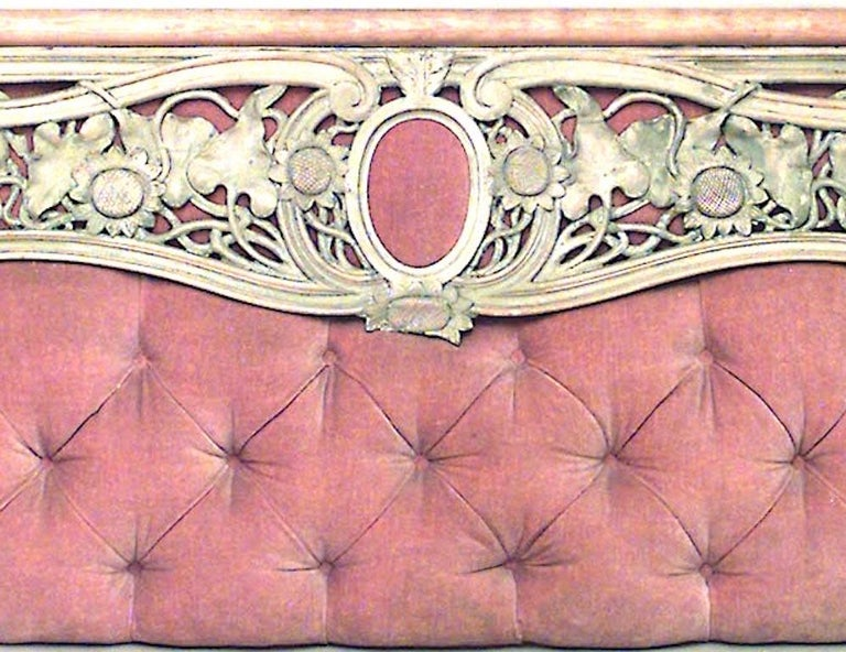 Art Nouveau stripped wall panel with pink velvet inset backing and carved floral filigree design.