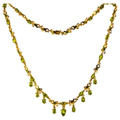 Art Nouveau Style 17.49 Carat White Diamond Peridot Enamel Yellow Gold Necklace