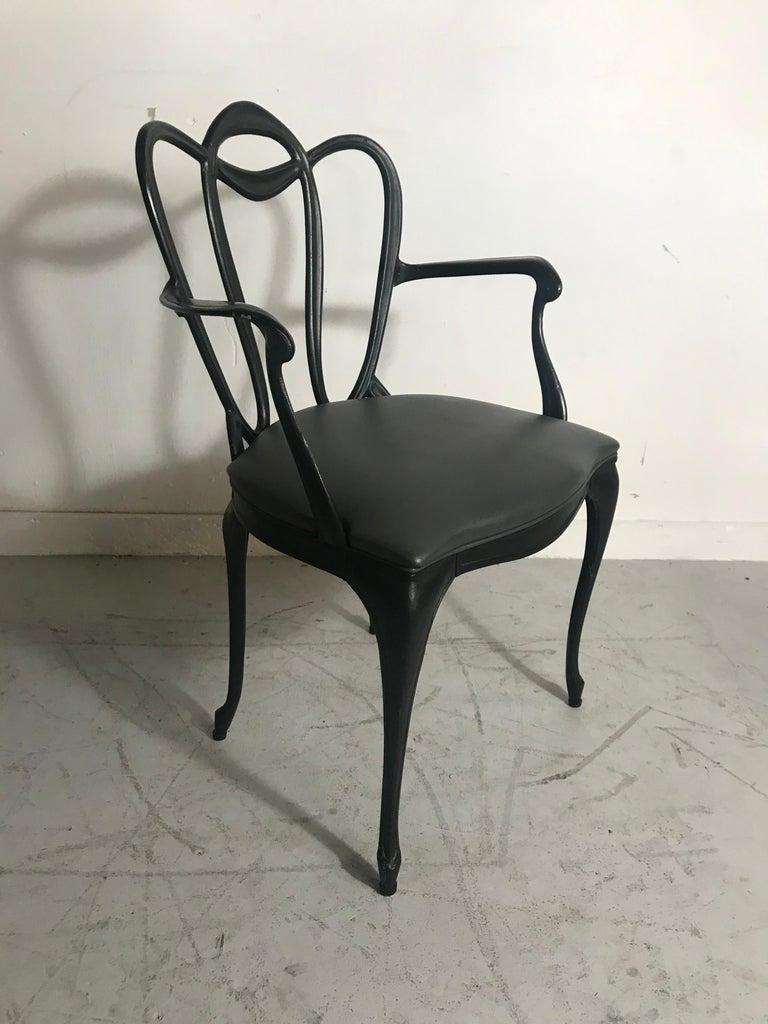 Art Nouveau style cast aluminum armchair by Crucible Products Corp. 1960, amazing design, extremely comfortable, retains original dark gray Naugahyde seat as well as original paper label, arm height 24.5