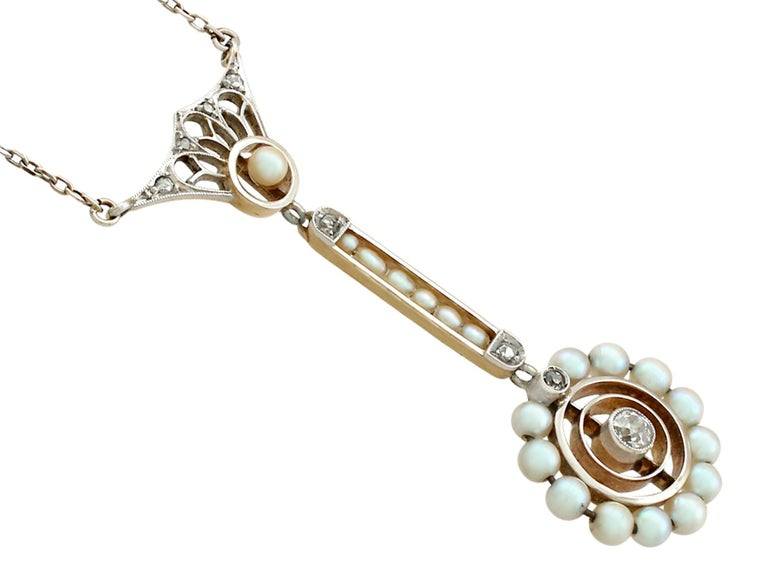 A fine and impressive antique pearl and 0.13 carat diamond pendant in 14 karat white and yellow gold; part of our authentic collection of Art Nouveau style jewelry/jewelry  This fine European Art Nouveau style antique pearl and diamond pendant has