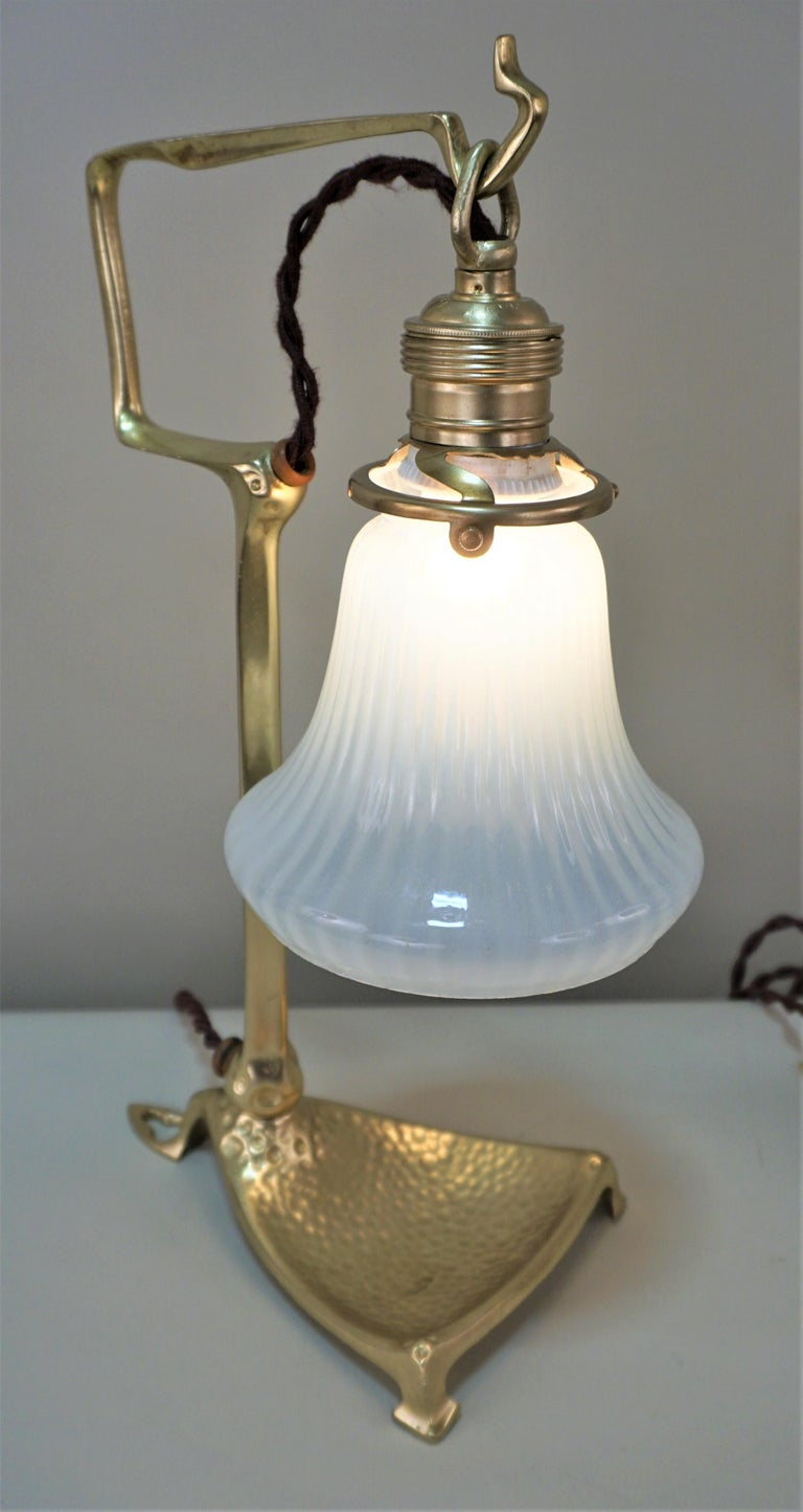 Pair of Friedrich Adler bronze Art Nouveau table or wall lamp with opaline glass shades.