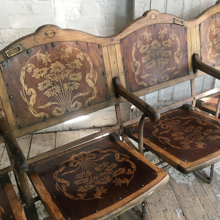 Art Nouveau French wooden theatre seats Beautiful folding theatre seats circa 1900-1910, France/Belgium Row of 4 seats The seats are decorated with a stencilled floral art nouveau style motif The row of 4 seats are connected as one unit, cannot