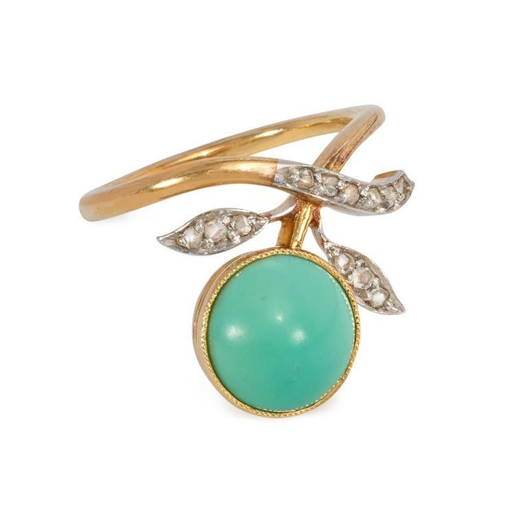 An Art Nouveau turquoise and rose-cut diamond ring of foliate berry design, in 18k gold and platinum.  Austro-Hungary  Face-up dimension: approximately 1.5cm long Current ring size: US 4.5; please contact us with re-sizing inquiries