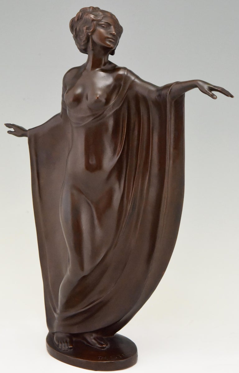 Elegant Art Nouveau bronze sculpture of a draped semi-nude dancer signed by Theodor Stundl, Austria, 1875-1934 With foundry mark. The bronze has a beautiful rich brown patina and stands on an oval bronze base.   A similar bronze is illustrated