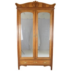 Art Nouveau Wardrobe / Armoire in Carved Fruit Wood, France, circa 1910