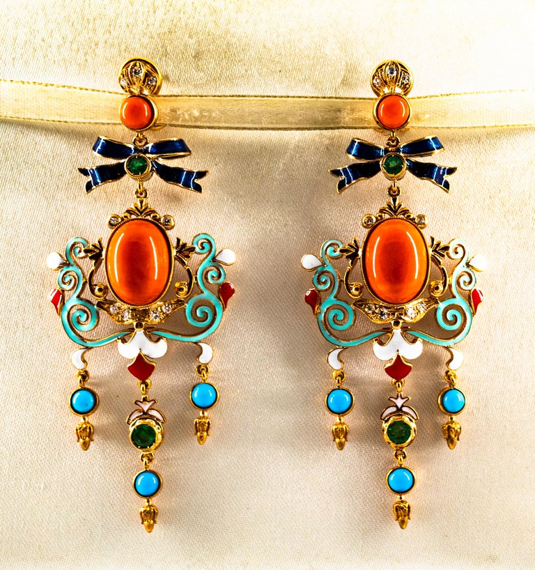 These Earrings are made of 9K Yellow Gold. These Earrings have  0.30 Carats of White Modern Round Cut Diamonds. These Earrings have 0.50 Carats of Emeralds. These Earrings have Mediterranean (Sardinia, Italy) Red Coral and Turquoise. These Earrings