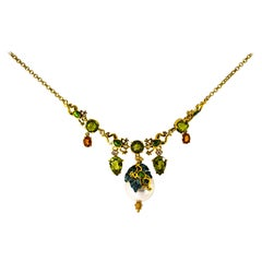Art Nouveau White Diamond Peridot Yellow Sapphire Pearl Yellow Gold Necklace