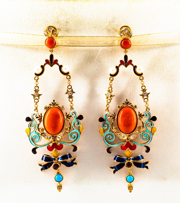 These Earrings are made of 9K Yellow Gold. These Earrings have  0.30 Carats of White Modern Round Cut Diamonds. These Earrings have 0.20 Carats of Rubies. These Earrings have Mediterranean (Sardinia, Italy) Red Coral and Turquoise. These Earrings